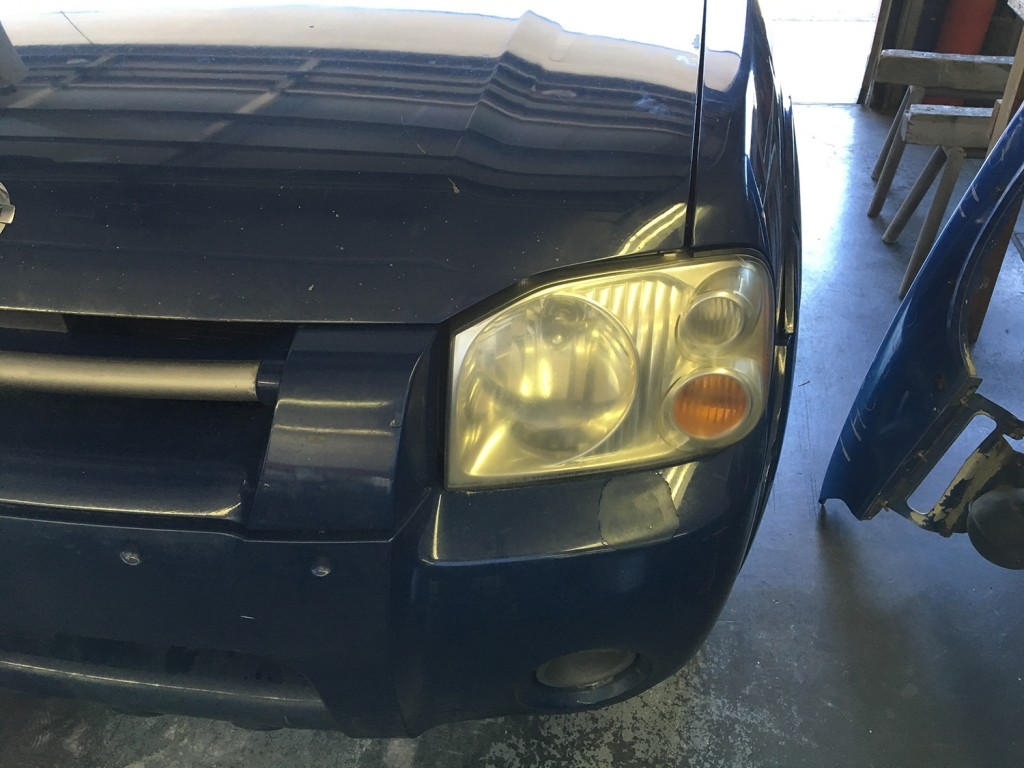 Before the polish or cleaning of headlight lens by Tune Tech Fairview Boise